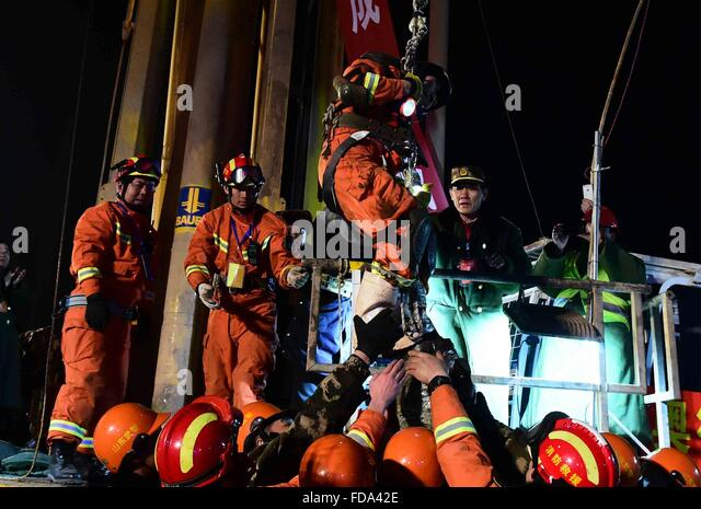 Pingyi, China's Shandong Province. 29th Jan, 2016. The first miner is lifted from a collapsed mine in Pingyi, - Stock Image