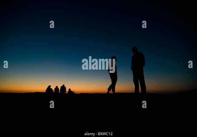 People in sunset - Stock-Bilder