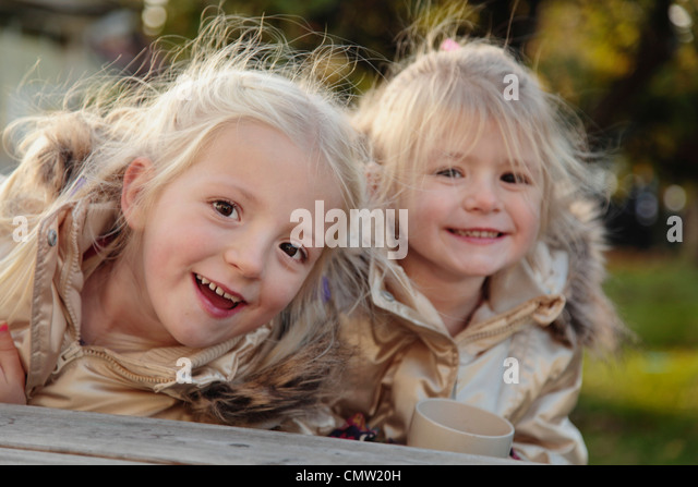 Portrait of sisters together - Stock Image