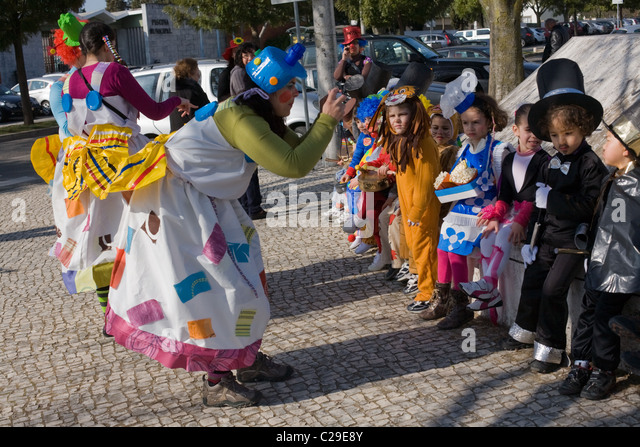 School children and teachers before carnival parade, in Beja, Portugal, Alentejo Region - Stock Image