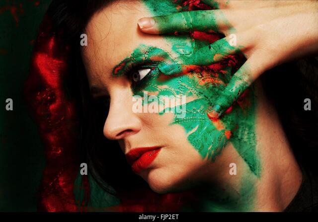 Close-Up Of Beautiful Woman With Face Paint - Stock Image