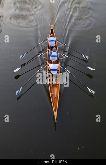 Rowing boat with three rowers, sculling, Water Sports, Sport - Stock Image