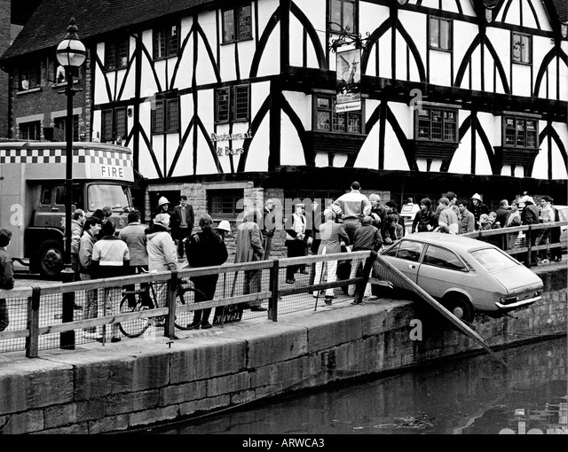 Car reversed through railings over River Witham in Lincoln - Stock Image