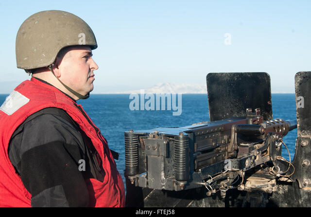 STRAIT OF GIBRALTAR (Nov. 6, 2014) Gunner's Mate Seaman Brian Brom, from Jasper, Ala., stands watch at a .50 - Stock Image
