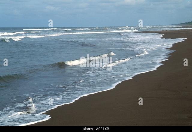 costa rica tortuguero beach waves rolling ashore nature natural escape green turtle nesting beach - Stock Image