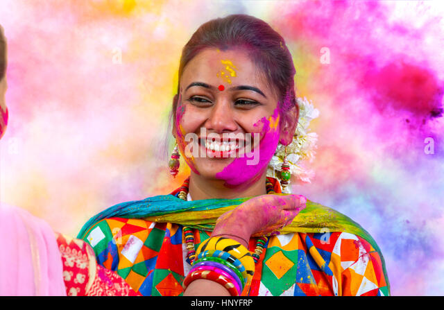 Portrait of  young Indian Woman celebrating Holi color festival - Stock-Bilder