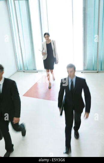 Business professionals arriving for another day of work - Stock Image