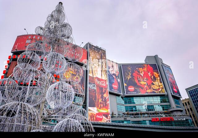 Dundas Square Coca-Cola Christmas billboards, corner of Yonge Street and Dundas Street, Toronto, Ontario, Canada. - Stock Image