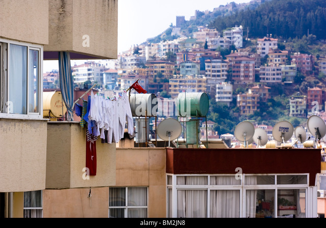 Washing line outside building in Alanya, Turkey. - Stock Image