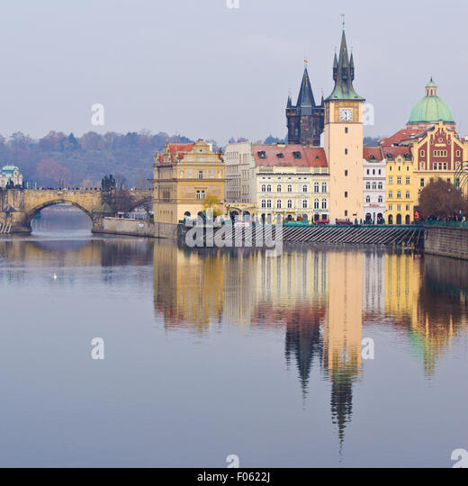 Charles Bridge, Karlovy Lazne and Lavka clock tower in Prague - Stock-Bilder