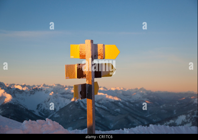 Close up of rural signposts in snow - Stock Image