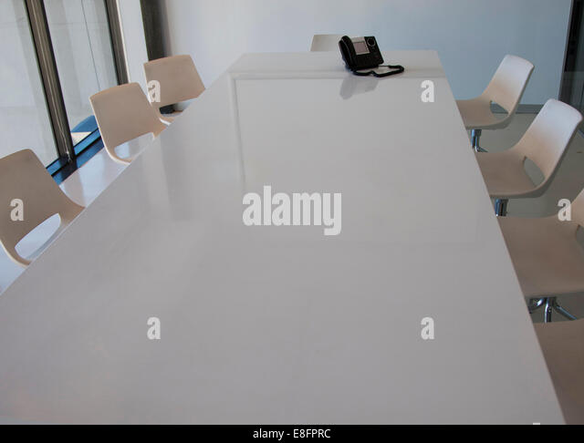 Contemporary office conference table and chairs with phone - Stock-Bilder