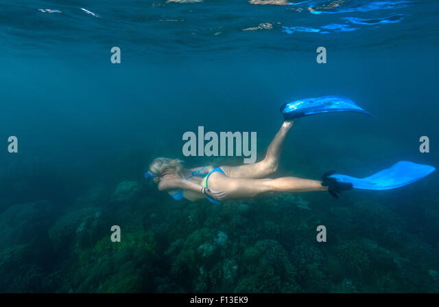 Woman snorkeling underwater, Bali, Indonesia - Stock Image