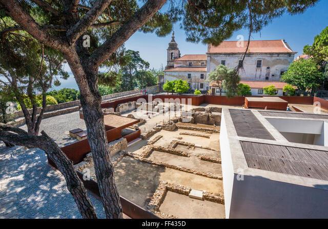 archaeological site at Castelo de Sao Jorge, St. George's Castle, with view of Igreja de Santa Cruz do Castelo, - Stock Image