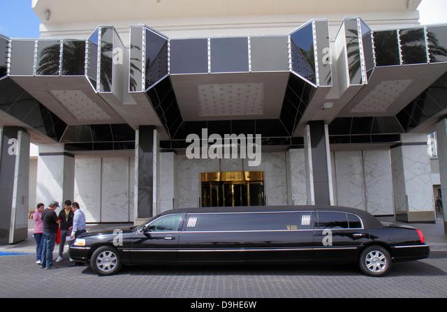 Nevada Las Vegas Las Vegas Hotel & Casino LVH entrance stretch limo limousine man driver customers clients - Stock Image