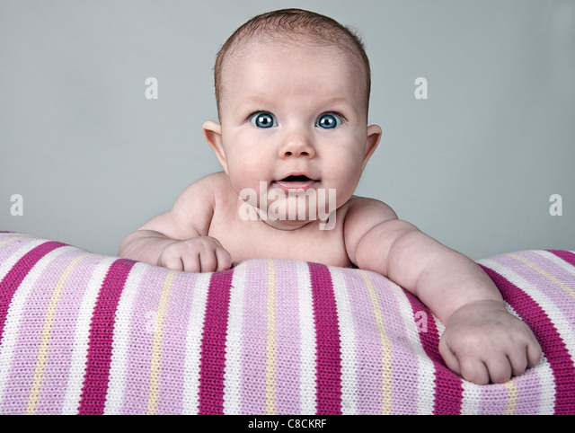 Beautiful Shot of a Pretty Baby Girl Smiling - Stock Image