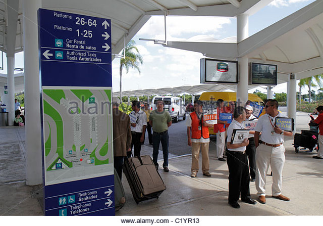 Cancun Mexico Yucatán Peninsula Quintana Roo Cancun International Airport Hispanic man ground transportation - Stock Image