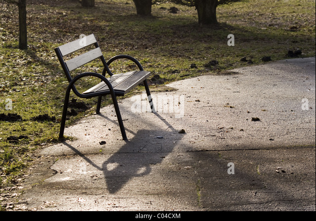 The photography of empty bench in the park square. Taken on January 2011. - Stock Image