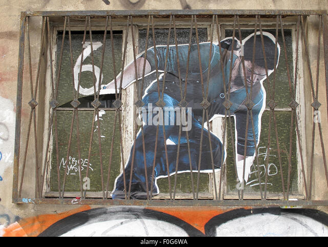 Berlin Mitte,Street art on walls,Germany - Man climbing from a window,6 - Stock Image