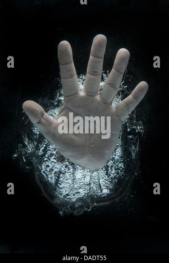Open hand beneath water - Stock Image