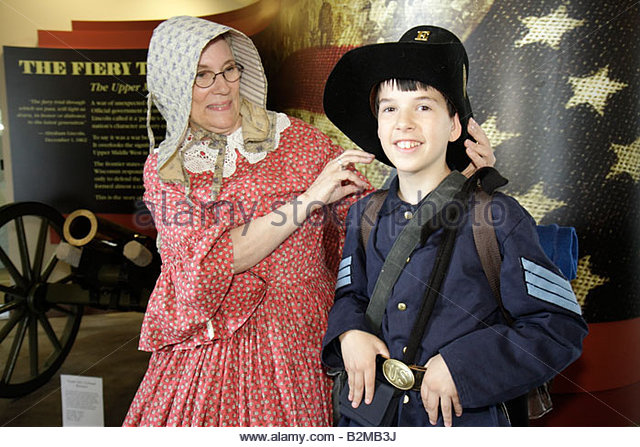 Wisconsin Kenosha Civil War Museum Civil War Days Park City Grays militia uniform Union woman boy education living - Stock Image