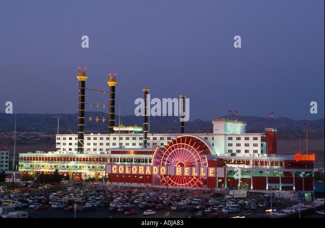 Nevada Southwest Laughlin Colorado Belle Hotel Casino steamboat shape Black Mountains beyond dusk NV NV - Stock Image