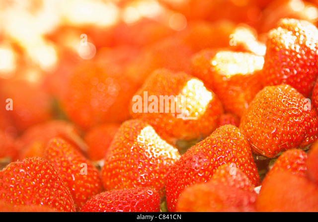 Close up of pile of strawberries - Stock Image