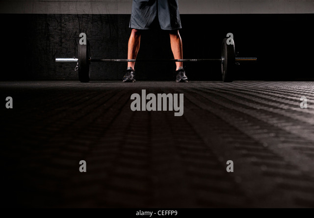 Man standing with weights - Stock Image