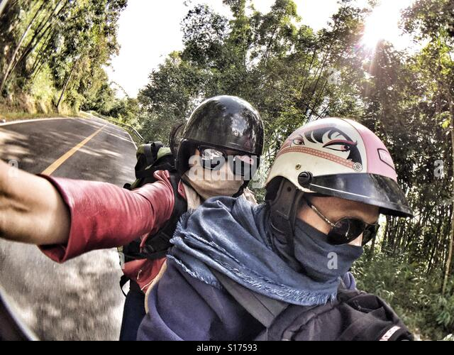 Traveller selfie on motorcycle - Stock Image