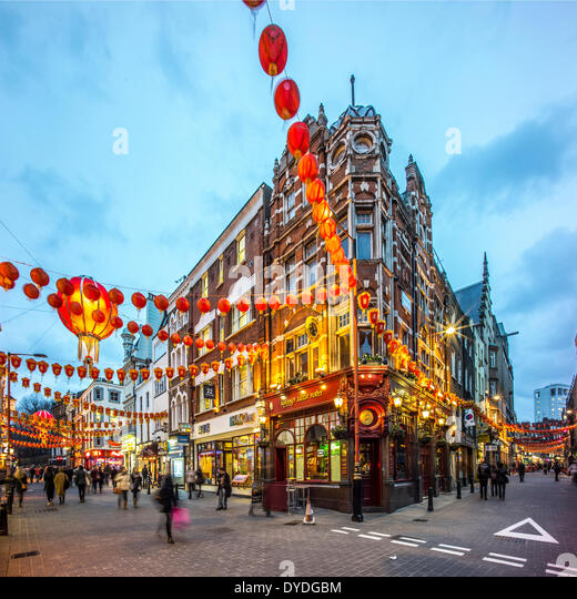 Decorations for Chinese New Year in Wardour Street in London at dusk. - Stock Image