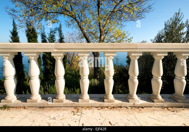 Decorative columns on a viewpoint deck near sea - Stock-Bilder