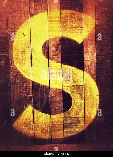 Letter S printed on wall - Stock-Bilder
