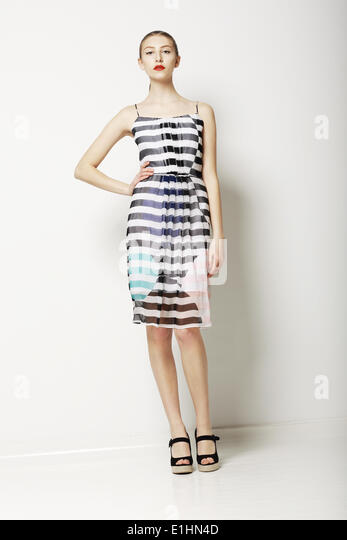 Contemporary Clothes Collection. Woman in Spring Light Dress with Grey Streaks. Fashion - Stock Image