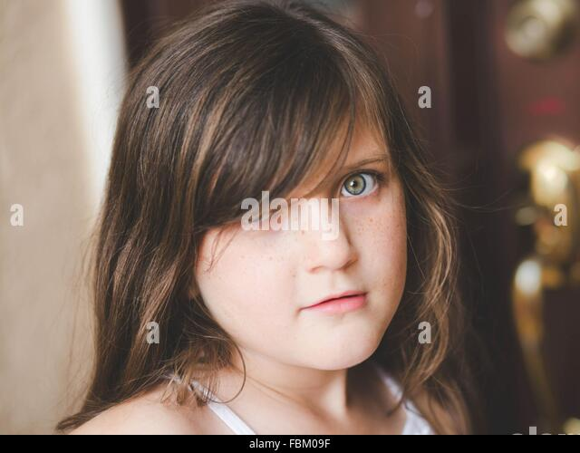 Pre Adolescent Girl Looking At Camera - Stock Image