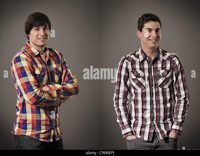 Two smiling men posing for portrait - Stock Image