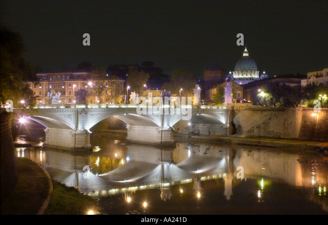 Ponte Vittorio Emanuele II, the River Tiber and St Peter's Basilica at night, Rome, Italy - Stock Image