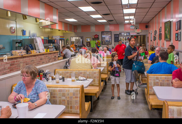 Shawnee Oklahoma OK famous old restaurant Hamburger King built in 1927 with phones at tables to order food - Stock Image