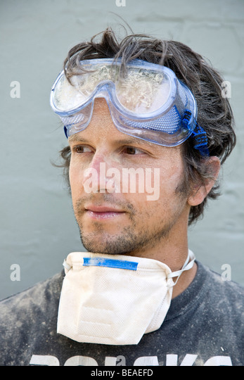 A man covered in dust, portrait - Stock Image