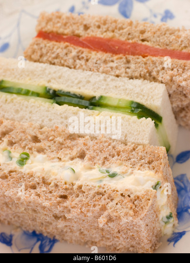 Afternoon Tea Finger Sandwiches- Egg and Cress Smoked Salmon and Cucumber - Stock Image