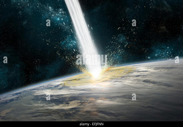 A comet strikes Earth. Clouds cover an ocean area of the planet. Stars and nebula serve as background. - Stock Image