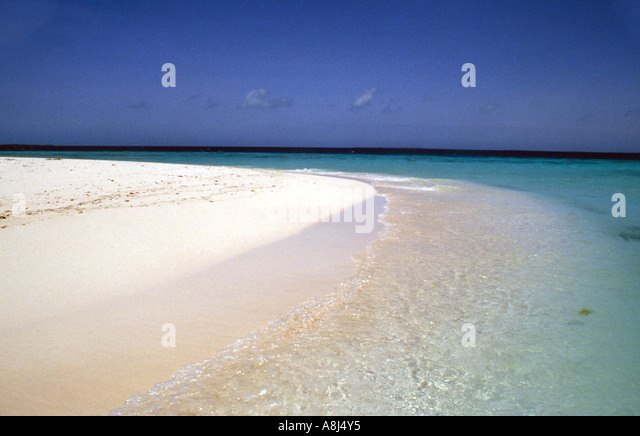 Tropics deserted beach - Stock Image