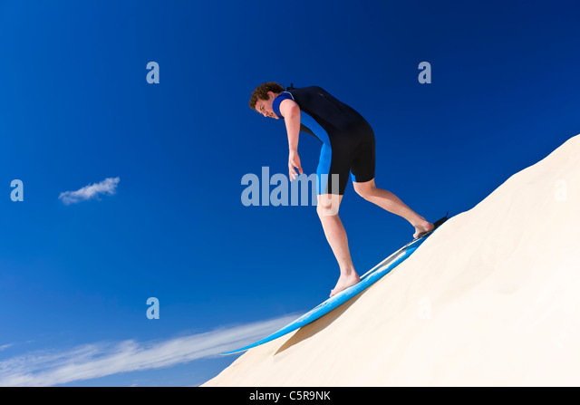 Surfing sand dunes. - Stock Image