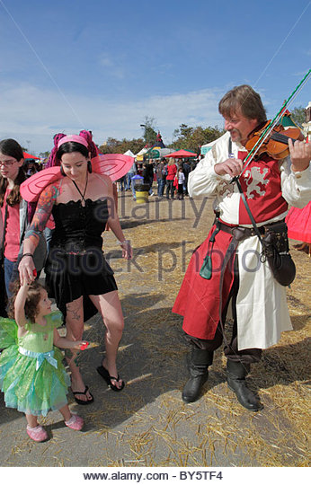 Florida Deerfield Beach Quiet Waters Park Florida Renaissance Festival costume violin music girl dancing - Stock Image