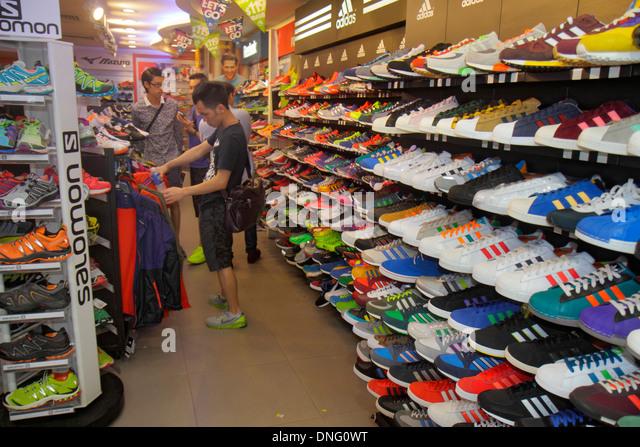 Hong Kong China Kowloon Mong Kok Fa Yuen Street Sneaker Street shopping fashion athletic shoe store inside Asian - Stock Image