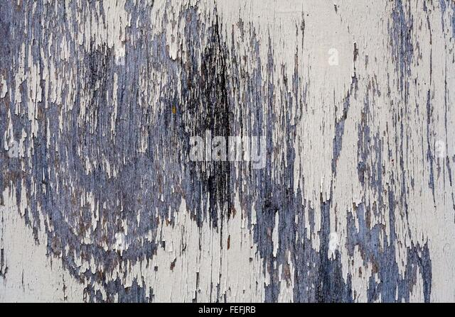 rusted blue and white discolored by time texture the metal surface. worm and corroded over time - Stock Image