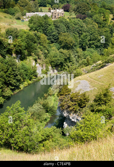 Cressbrook Hall high above the River Wye at Water cum Jolly Dale in the Derbyshire Peak District - Stock Image