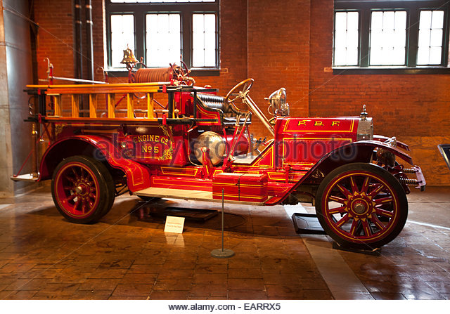 A vintage early 20th Century fire engine. - Stock Image