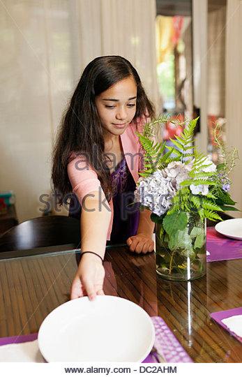 Girl setting table - Stock-Bilder