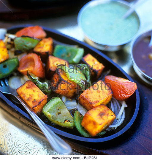 Roasted sweet potatoes, peppers and tomatoes - Stock Image