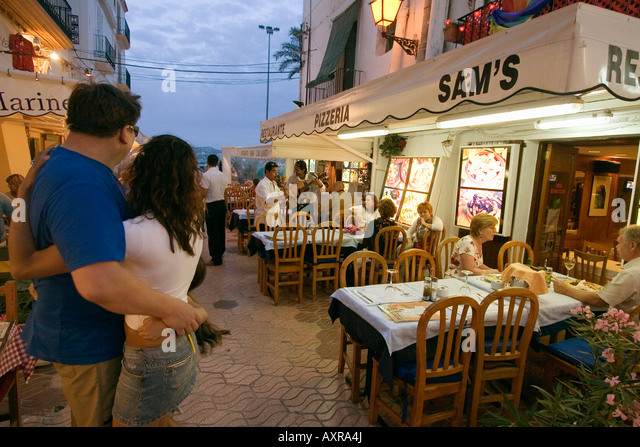 Spain Baleares island Ibiza town by night restaurants near harbour Sa Penya - Stock Image